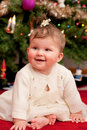 Cute Infant Baby in front of Christmas Tree Royalty Free Stock Images