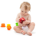 Cute infant boy with apple little caucasian months old sits and eats red on white background Stock Photos