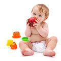 Cute infant boy with apple little caucasian months old sits and eats red on white background Stock Image