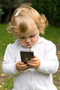 Cute infant with cellular baby girl new mobile phone Stock Photos