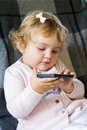 Cute infant with cellular baby girl new mobile phone Royalty Free Stock Images