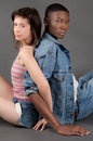 Cute interracial couple a portrait of a white women and black men with interlocked arms Stock Photos
