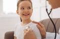 Cute joyful little child feeling healthy