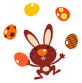 Cute jumping bunny juggling with eggs Royalty Free Stock Photos