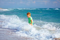 Cute kid boy having fun in sea surf happy Stock Photos