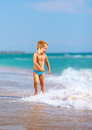 Cute kid boy having fun in sea surf happy Royalty Free Stock Photography