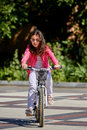 Cute kid girl in blue helmet going to ride her bike Royalty Free Stock Photo