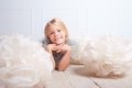 Cute kid girl lying on floor in room Royalty Free Stock Photo