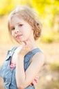 Cute Kid Girl On Nature Backgr...