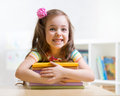 Cute kid girl preschooler with books indoor Royalty Free Stock Images
