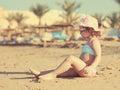 Cute kid girl sunbathing on beach