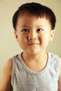 Cute kid looking to the side child away with a smile Royalty Free Stock Image