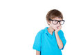 A cute kid lost in serious thoughts with his hand on chin Royalty Free Stock Photo