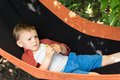 A cute kid lying on the swing close up image of Royalty Free Stock Image