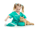 Kid playing doctor with cat Royalty Free Stock Photo