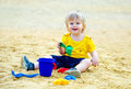 Cute kid in the sandpit adorable toddler playing with his toys Stock Image