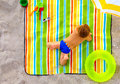 Cute kid sunbathing on colorful beach summer Royalty Free Stock Photo