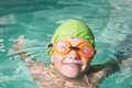 Cute kid swimming in the pool Royalty Free Stock Photo