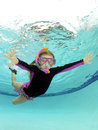 Cute kid underwater in pool swimming summer a Royalty Free Stock Photography