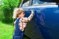 Cute kid washing parents car Royalty Free Stock Photo