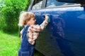 Cute kid washing parents car Royalty Free Stock Photo