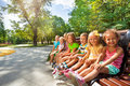Cute kids on the bench in park toggether Royalty Free Stock Photo