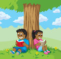 Cute kids reading under a tree old red phone ringing off the hook Royalty Free Stock Photos