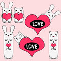Cute kitties and bunnies holding hearts Stock Images