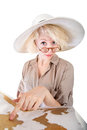 Cute lady pointing at map european woman in safari hat Stock Photography