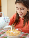 Cute latin girl eating breakfast at home Royalty Free Stock Photography