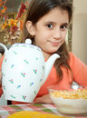 Cute latin girl eating breakfast at home Royalty Free Stock Images