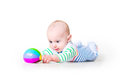 Cute laughing funny baby boy learning to crawl