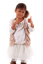 Cute little african asian girl making thumbs up gesture isolat over white background Royalty Free Stock Images