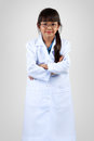 Cute little asian girl dressed like a doctor isoated on grey background Stock Photo
