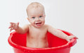 Cute little babe is bathed in a basin Royalty Free Stock Photo