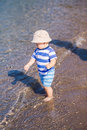 Cute little baby boy exploring the beach at seaside Stock Image