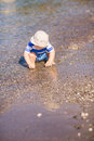 Cute little baby boy exploring the beach at seaside Stock Images