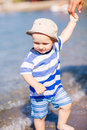 Cute little baby boy exploring the beach at seaside Royalty Free Stock Photo