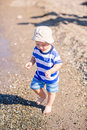 Cute little baby boy exploring the beach at seaside Royalty Free Stock Photography