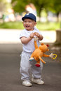 A cute little baby boy playing in the park Royalty Free Stock Photography