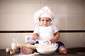 Cute little baby in a cook cap laughs Royalty Free Stock Photography