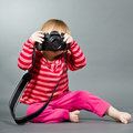 Cute little baby with digital photo camera Royalty Free Stock Photo
