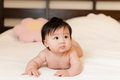 Cute little baby girl lies bed naked Stock Images