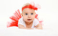 Cute little baby girl lying in red skirt on bed Royalty Free Stock Photo