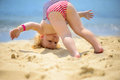 Cute little baby girl making yoga exercises at ocean beach Royalty Free Stock Photos