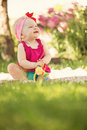 Cute little baby girl portrait of playing in the garden with copy space Stock Image