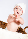 Cute little baby infant in basket with teddy Royalty Free Stock Photography