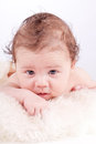 Cute little baby infant toddler on white blanket portrait Stock Photography