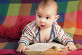 Cute little baby reading book Royalty Free Stock Photo