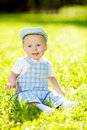 Cute little baby in summer park on the grass sweet baby outdoo outdoors smiling emotional kid a walk smile of a child Stock Photography